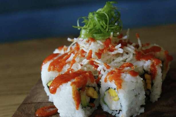 The Buenazo Roll with shrimp, avocado, mango, sesame seeds, crispy noodles and sweet aji sauce.