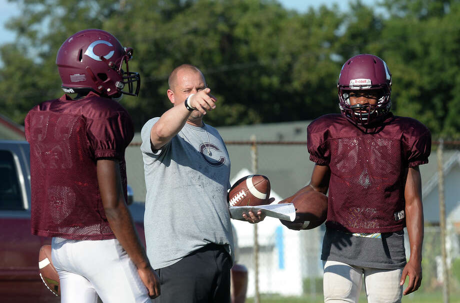 From left, Chris Boudreaux, Toby Foreman and Dessane Davis talk about quarterback drills during practice on Tuesday. Photo taken Tuesday, September 20, 2016 Guiseppe Barranco/The Enterprise Photo: Guiseppe Barranco, Guiseppe Barranco/The Enterprise