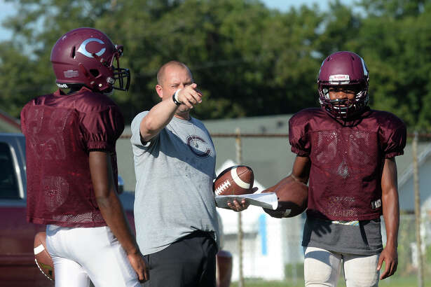 From left, Chris Boudreaux, Toby Foreman and Dessane Davis talk about quarterback drills during practice on Tuesday. Photo taken Tuesday, September 20, 2016 Guiseppe Barranco/The Enterprise