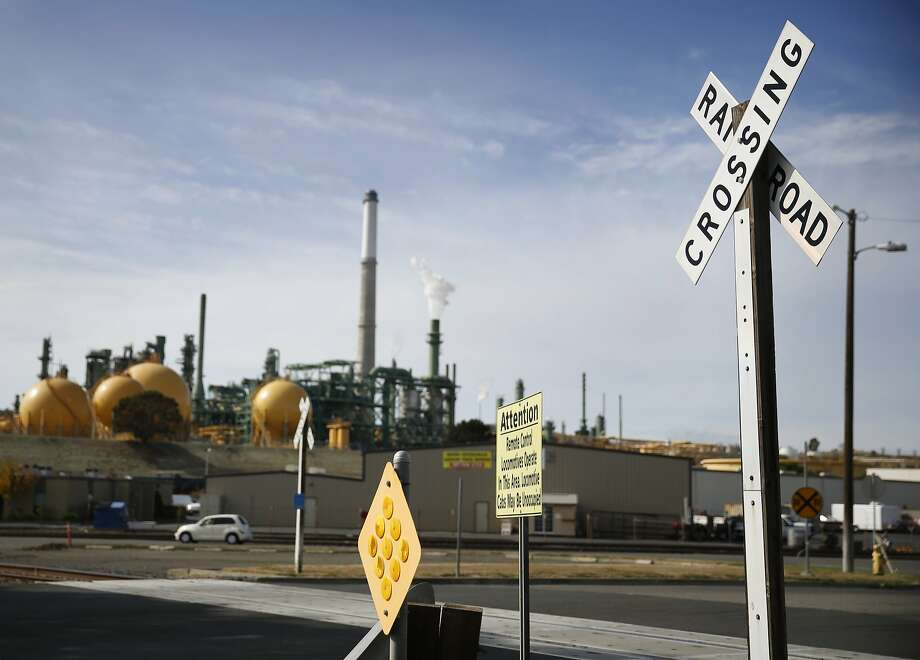 The Valero refinery is seen in the background behind signage for a railroad crossing on Wednesday, October 22, 2014 in Benicia, Calif. Photo: Lea Suzuki, The Chronicle