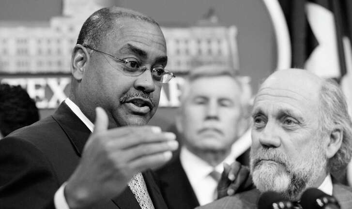 """Sen. Rodney Ellis, D-Houston, left, speaks during a news conference Monday, Feb. 2, 2009, in Austin, Texas. Sen. Troy Fraser, R-Horseshoe Bay, is in the center. Tom """"Smitty"""" Smith, with Public Citizen, is on the right. Clean power proponents and lawmakers released a study on solar power's job creation and energy savings potential in Texas and to highlight bipartisan support for increasing solar power generation in Texas. (AP Photo/Harry Cabluck)"""