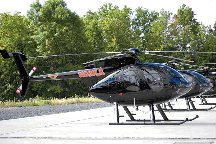 Two black MD500 helicopters used to perform Eversource's high-resolution camera inspections over Connecticut.  Photo: Contributed: Eversource Energy