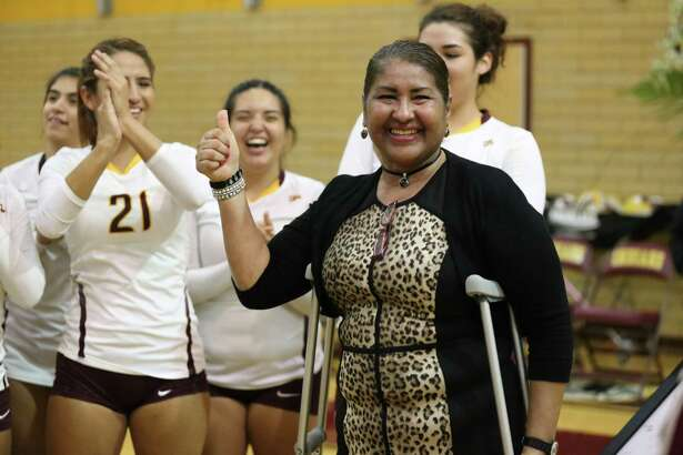 Sylvia Cardenas recently celebrated her 600th victory as head volleyball coach at Harlandale High School. Here she is shown receiving congratulations from her team after the milestone victory on Sept. 6.