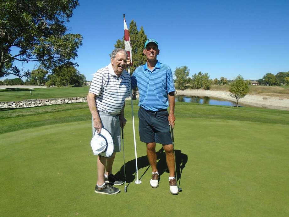 Barry Gibbons, of Ridgefield, (right) and his father Edward Gibbons (left) on Sunday, Sept. 18, 2016, at Valley Country Club, in Centennial, Colo. Barry set the record for most rounds of golf played in a year at 612, and is on pace to set the streak as high as 800 rounds before year's end. Photo: Contributed Photo: Joy Gibbons
