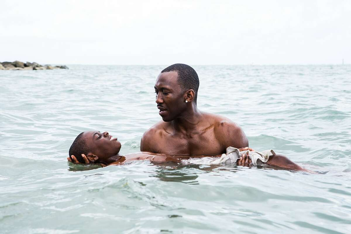 This image released by A24 Films shows Alex Hibbert, left, and Mahershala Ali in a scene from the film,