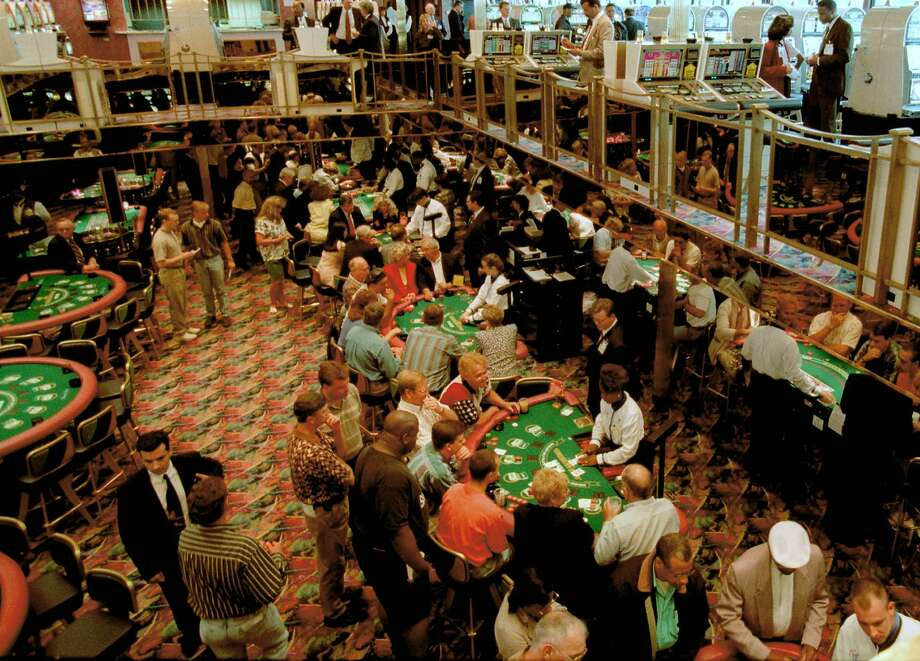 Gamblers fill the tables on the Majestic Star Casino in Gary, Ind. The company acquired the Trump gaming boat in 2007. Photo: Michael Conroy, Associated Press
