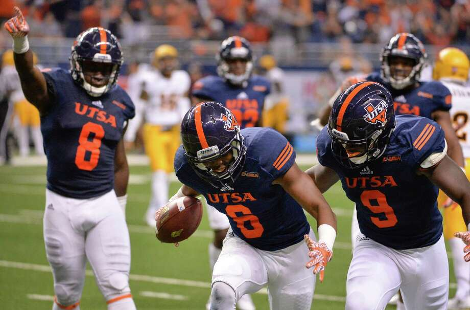 UTSA cornerback Aneas Henricks (6) celebrates a fumble recovery with teammates Michael Egwuagu (8) and Marcos Curry during the second half of against Arizona State on Sept. 16, 2016, in San Antonio. Photo: Darren Abate /Associated Press / FR115 AP