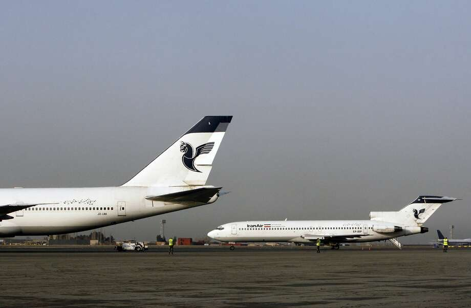 Two passenger planes of Iran's national air carrier, Iran Air, sit at the Mehrabad Airport in Tehran, Iran, in 2008. Most Iranian planes were purchased before the 1979 Islamic Revolution. Photo: Vahid Salemi, Associated Press