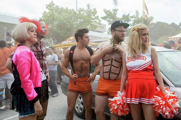 "This image released by Universal Pictures shows, from left, Carla Gallo, Ike Barinholtz, Zac Efron, Seth Rogen and Rose Byrne in a scene from ""Neighbors 2: Sorority Rising."" (Chuck Zlotnick/Universal Pictures via AP) ORG XMIT: NYET603"