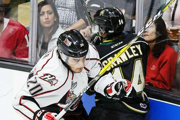 RED DEER, AB - MAY 29:  Brandon Crawley #14 of the London Knights (OHL) collides with Timo Meier #20 of the Rouyn-Noranda Huskies (QMJHL) during the Memorial Cup Final on May 29, 2016 at the Enmax Centrium in Red Deer, Alberta, Canada. (Photo by Codie McLachlan/Getty Images)
