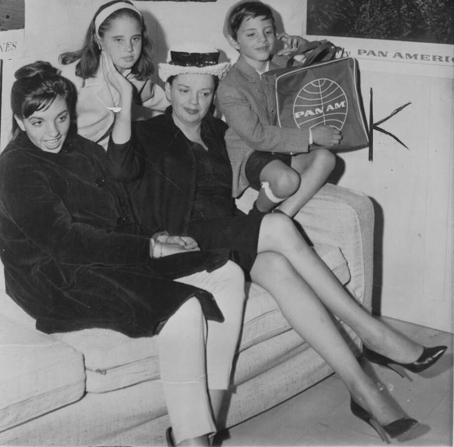 Judy Garland surrounded by daughters Liza Minnelli (left) and Lorna Luft, and son, Joey Luft, in 1962 in London.