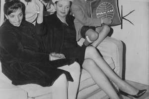 Judy Garland with her children, (l to r) Liza Minnelli, Lorna Luft and son Joe, at the airport, on their way to London.   AP Photo  dated April 28 1962, Photo ran 04/29/1962, p. 37
