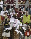 Ohio State's Noah Brown catches a touchdown pass behind the back of Oklahoma's Michiah Quick during the second quarter of an NCAA college football game Saturday, Sept. 17, 2016, in Norman, Okla. (Billy Hefton/Enid News & Eagle via AP)