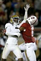 Stanford wide receiver Francis Owusu (6) catches a touchdown pass behind the back of UCLA defensive back Jaleel Wadood during the second half of an NCAA college football game Thursday, Oct. 15, 2015, Stanford, Calif. (AP Photo/Tony Avelar)
