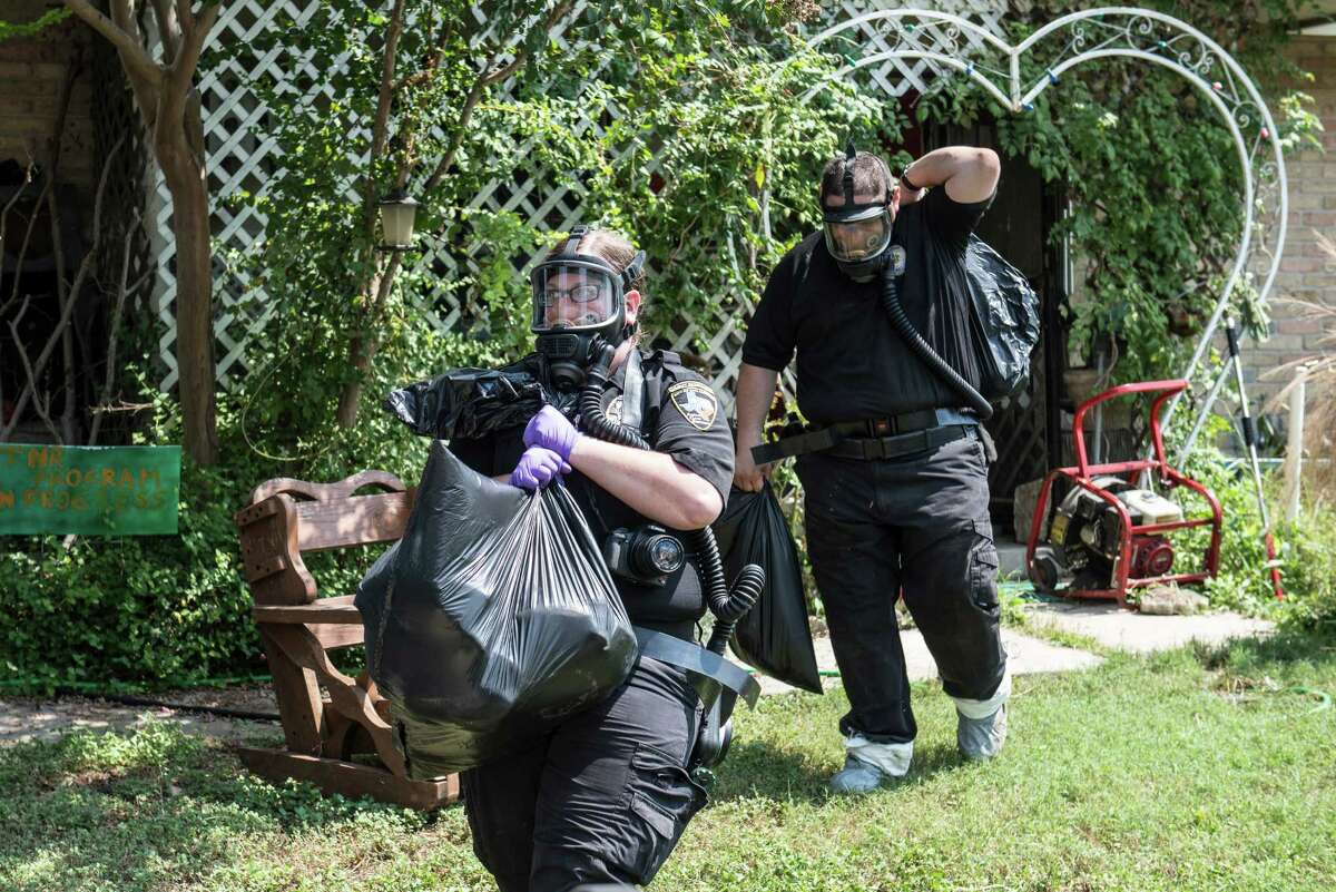 San Antonio investigators remove animals from a home on the Southwest Side Wednesday morning, September 21, 2016.