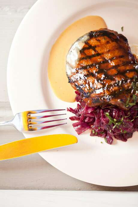 A classic from Mustards Grill, still on the menu: Mongolian Pork Chop. Photo: Jason Henry, Special To The Chronicle