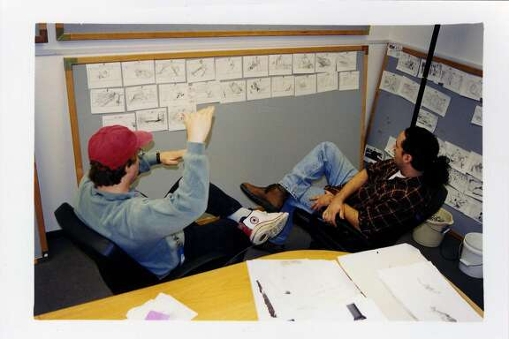 "Director Brad Bird and storyboard artist Mark Andrews during production of the 1999 film ""The Iron Giant."""