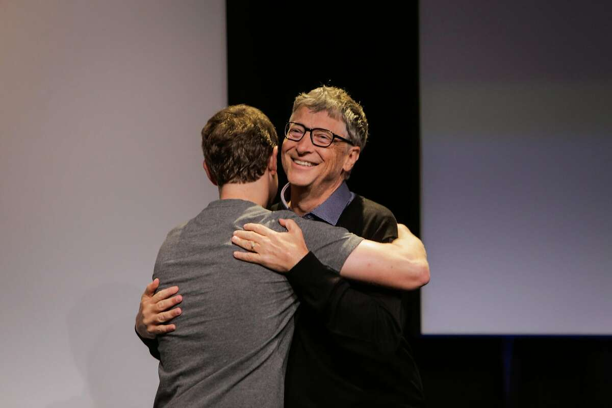 Bill Gates, co-founder of Microsoft hugged Facebook CEO Mark Zuckerberg (left) during an announcement of the new Chan-Zuckerberg initiative to fund disease-prevention research, at the Rutter center at UCSF, in San Francisco, California, on Wednesday, Sept. 21, 2016.