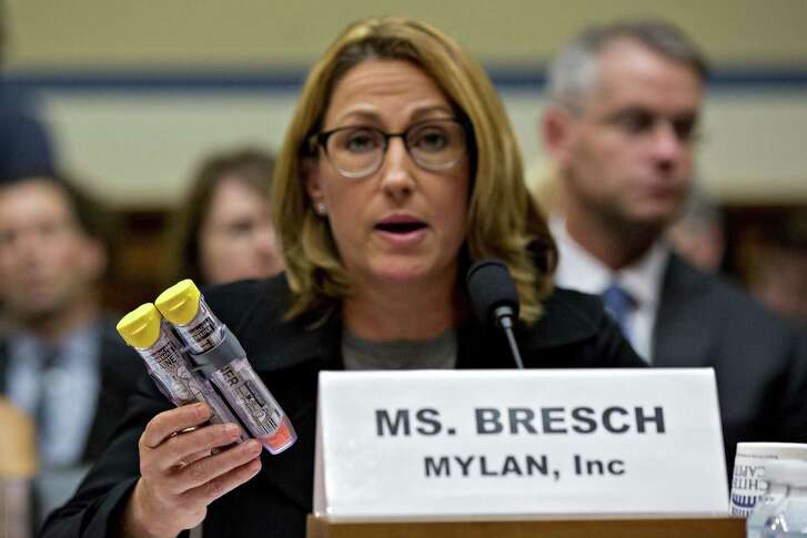Mylan CEO Heather Bresch holds up Mylan EpiPen medication while speaking during a House Oversight and Government Reform Committee hearing Wednesday in Washington. Lawmakers questioned Bresch about how the company raised the price of the life-saving injection to $600 for a two-pack, from $57 a shot when it took over sales of the product in 2007.
