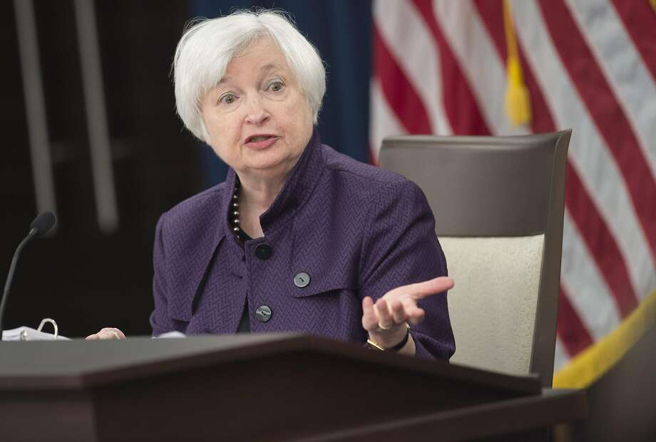 Federal Reserve Chairwoman Janet Yellen outlines the Fed's strategy on the economy during a news conference following Wednesday's announce ment. Photo: SAUL LOEB, AFP/Getty Images