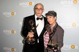Actor Jeffrey Tambor (L) and television writer and director Jill Soloway attend the Amazon Emmy Award afterparty at Sunset Tower, in West Hollywood, California, on September 18, 2016. / AFP PHOTO / TOMMASO BODDITOMMASO BODDI/AFP/Getty Images