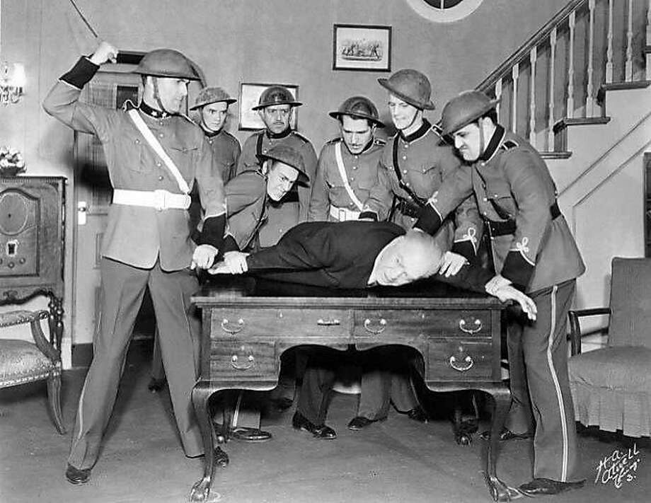 "Shad LeDue and members of the fascist Corpo militia beat up Doremus Jessup in a scene from Sinclair Lewis' ""It Can't Happen Here,"" performed at Chicago's Blackstone Theatre in 1936. Photo: National Archives, Records Of The Works Projects Administration"