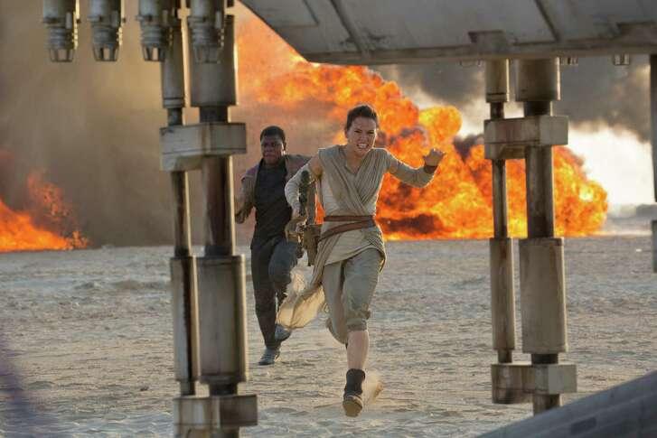 "John Boyega and Daisy Ridley star in ""Star Wars: The Force Awakens."""