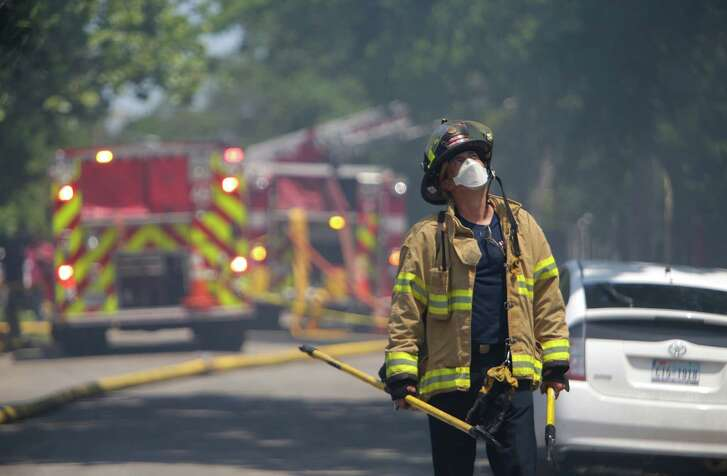Four hundred firefighters responded to the Spring Branch warehouse over two days and didn't know what chemicals were on site. (Mark Mulligan / Houston Chronicle )