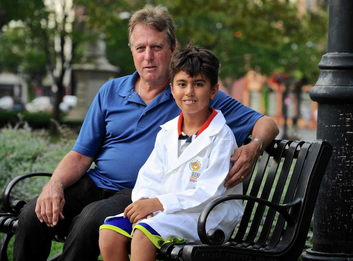 Gary Prybylski Jr, 9, of Danbury, and his father Gary Prybylski Sr sit on a bench in front of the Danbury Public Library on Tuesday afternoon, September 20, 2016, in Danbury, Conn. The library is meeting place of the new STEM Scouts Danbury Library Elementary School Lab #1010, which is part of the Boy Scouts. Prybylski Sr brought the new scouting program to Danbury. The group will be holding a sign-up & demo at the Danbury War memorial on Monday, September 26th, from 5:30 to 6:30 pm.