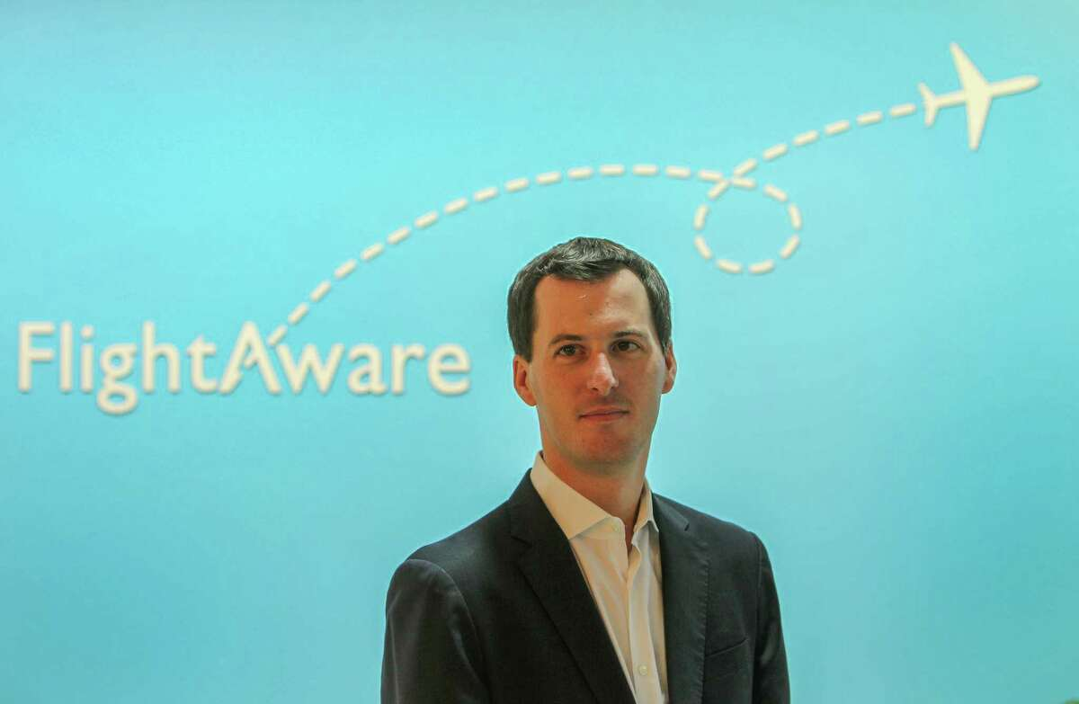FlightAware CEO Daniel Baker photographed Wednesday, Sept. 21, 2016, in Houston. The Houston-based FlightAware is partnering with another company to help track planes around the world, hoping to prevent another Malaysia Airlines flight MH370 that went missing in 2014. Using satellites, it will be able to track planes in real time across the globe. ( Steve Gonzales / Houston Chronicle )