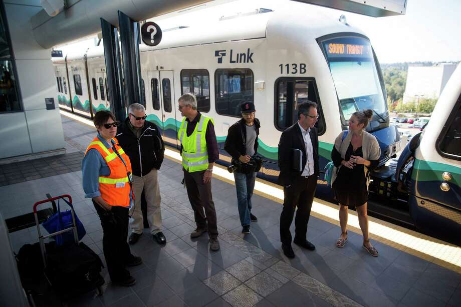 People, media gather for speakers during a press event at the new Angle Lake Station in SeaTac on Wednesday, Sept. 21, 2016. The new station that extends service 1.6 miles south begins Saturday. Photo: GRANT HINDSLEY, SEATTLEPI.COM / SEATTLEPI.COM