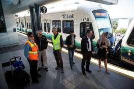 People, media gather for speakers during a press event at the new Angle Lake Station in SeaTac on Wednesday, Sept. 21, 2016. The new station that extends service 1.6 miles south begins Saturday.