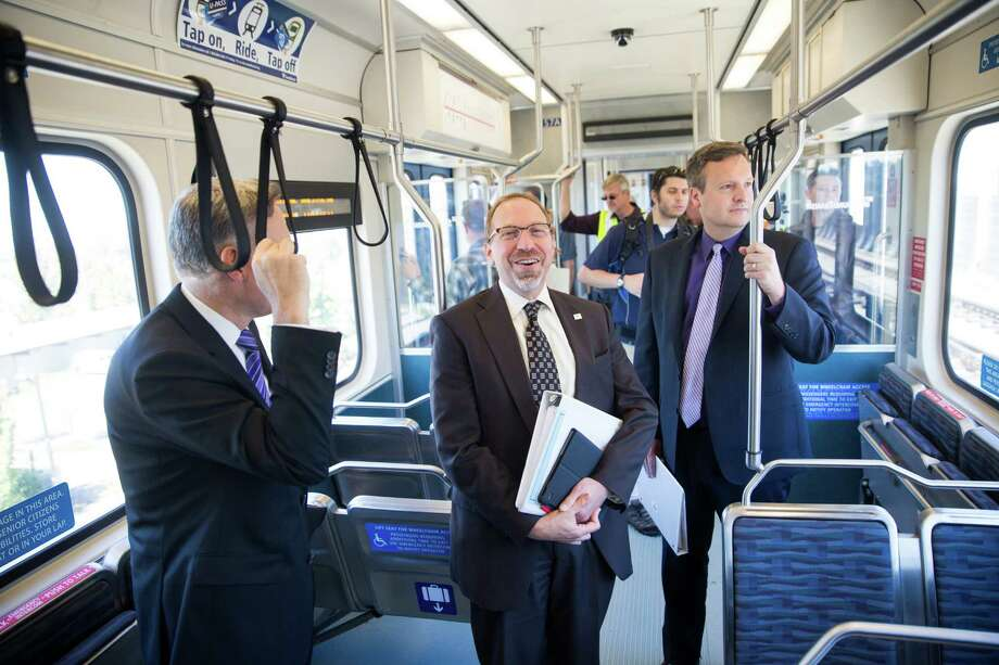 File photo - King County Executive Dow Constantine, Chief Executive Officer of Sound Transit, Peter Rogoff, and King county council and sound transit board member, Dave Upthegrovetalk ride with the press to the new Angle Lake Station in SeaTac on Wednesday, Sept. 21, 2016. Photo: GRANT HINDSLEY, SEATTLEPI.COM / SEATTLEPI.COM