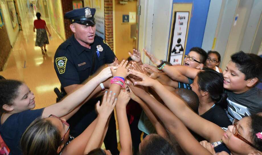 Norwalk Police Officer Theodore Garbera gets students in the 5th grade to come together for a Wooaaa Silvermine! cheeer during lunch served for Norwalks Police Department at Silvermine Elementary School on Wednesday September 21 2016 in Norwalk Conn Photo: Alex Von Kleydorff / Hearst Connecticut Media / Connecticut Post