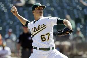 Oakland Athletics starting pitcher Daniel Mengden throws to the Houston Astros during the first inning of a baseball game Wednesday, Sept. 21, 2016, in Oakland, Calif. (AP Photo/Marcio Jose Sanchez)