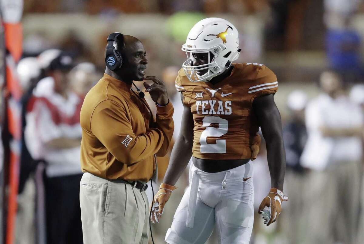 Texas coach Charlie Strong talks with cornerback Kris Boyd (2) during the second half against UTEP on Sept. 10, 2016, in Austin.