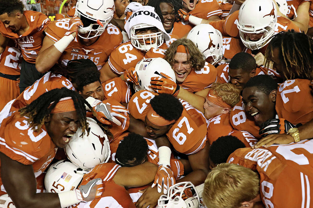 Texas teammates celebrate after they defeated Notre Dame in double overtime on Sept. 4, 2016, in Austin.