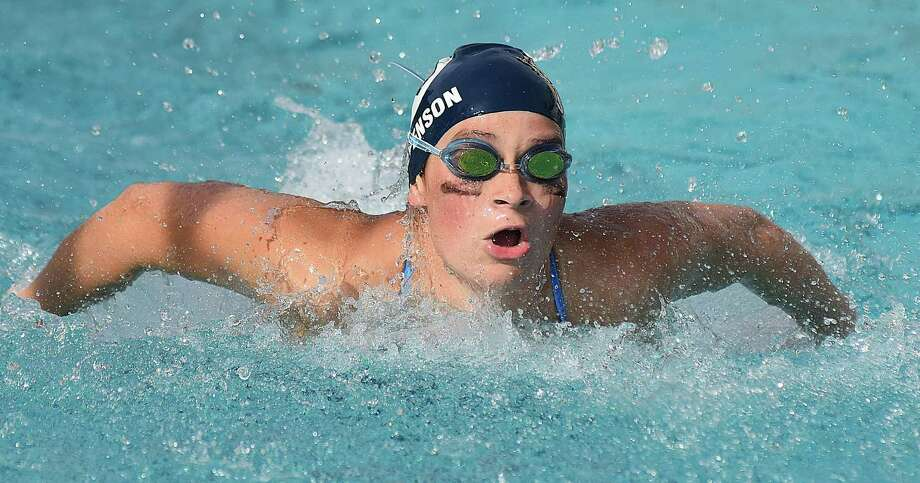 Wilton's Katie Stevenson powers through the water in the 100 butterfly during Wednesday's dual meet against Trumbull at the Wilton Y pool. Photo: John Nash / Hearst Connecticut Media / Norwalk Hour