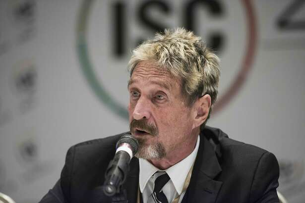 John McAfee, founder of the eponymous anti-virus company, speaks to journalists at the China Internet Security Conference in Beijing on August 16, 2016. / AFP PHOTO / FRED DUFOURFRED DUFOUR/AFP/Getty Images