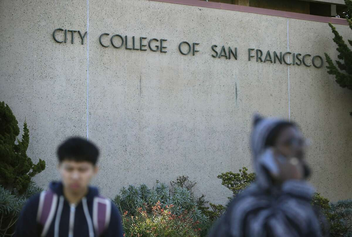 People walk past a sign for City College of San Francisco at the Ocean Campus in November 2015.