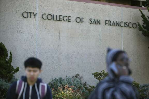 People walk past a sign for City College of San Francisco at the Ocean  Campus on Monday, November 16,  2015 in San Francisco, Calif.