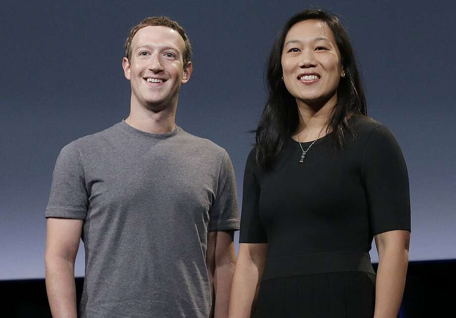In this Tuesday, Sept. 20, 2016, photo, Facebook CEO Mark Zuckerberg and his wife, Priscilla Chan, smile as they prepare for a speech in San Francisco. Zuckerberg and Chan have a new lofty goal: to cure, manage or eradicate all disease by the end of this century. To this end, the Chan Zuckerberg Initiative, the couple's philanthropic organization, is committing significant financial resources over the next decade to help accelerate basic science research. (AP Photo/Jeff Chiu) Photo: Jeff Chiu, Associated Press