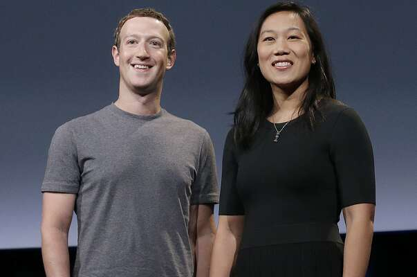 In this Tuesday, Sept. 20, 2016, photo, Facebook CEO Mark Zuckerberg and his wife, Priscilla Chan, smile as they prepare for a speech in San Francisco. Zuckerberg and Chan have a new lofty goal: to cure, manage or eradicate all disease by the end of this century. To this end, the Chan Zuckerberg Initiative, the couple's philanthropic organization, is committing significant financial resources over the next decade to help accelerate basic science research. (AP Photo/Jeff Chiu)