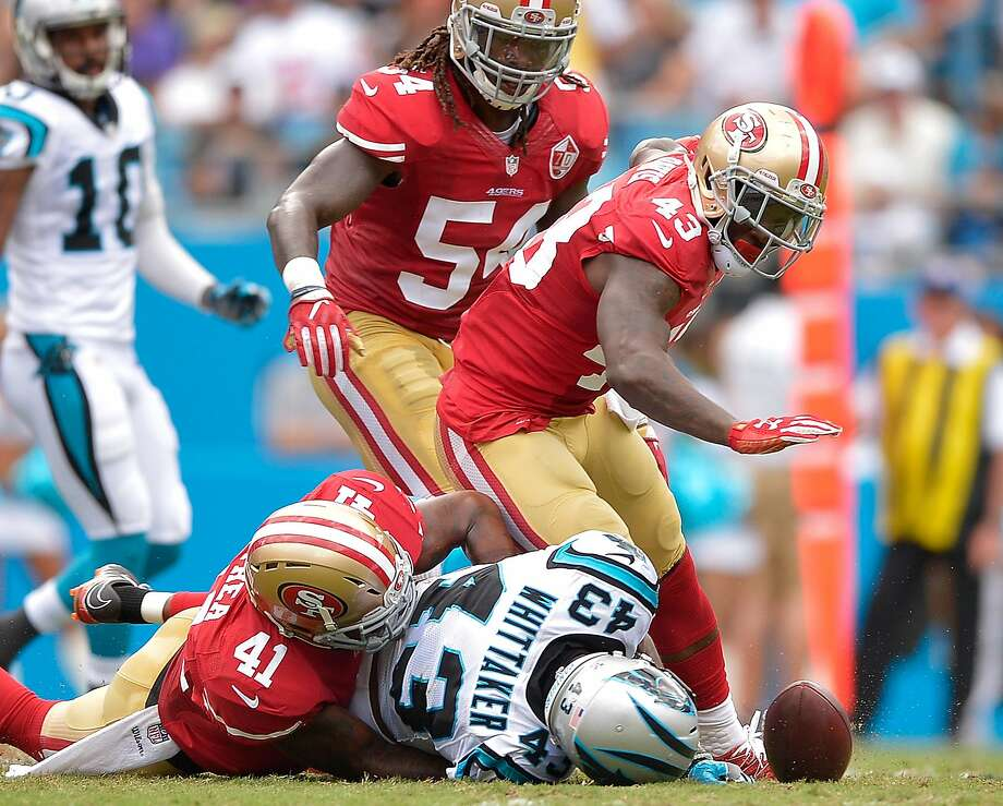 Antoine Bethea (41) of the 49ers forces a fumble by the Panthers' Fozzy Whittaker (43) during the loss in Carolina on Sunday. A wrong move by Bethea at another point, however, led to a TD. Photo: Grant Halverson, Getty Images