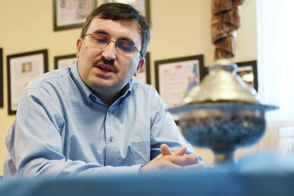 Veysel Ucan, executive director of the Turkish Cultural Center of Albany, talks about exiled Turkish Muslim clerk, Fetullah Gulen, during an interview on Wednesday, July 27, 2016, in Menands, N.Y. (Paul Buckowski / Times Union)