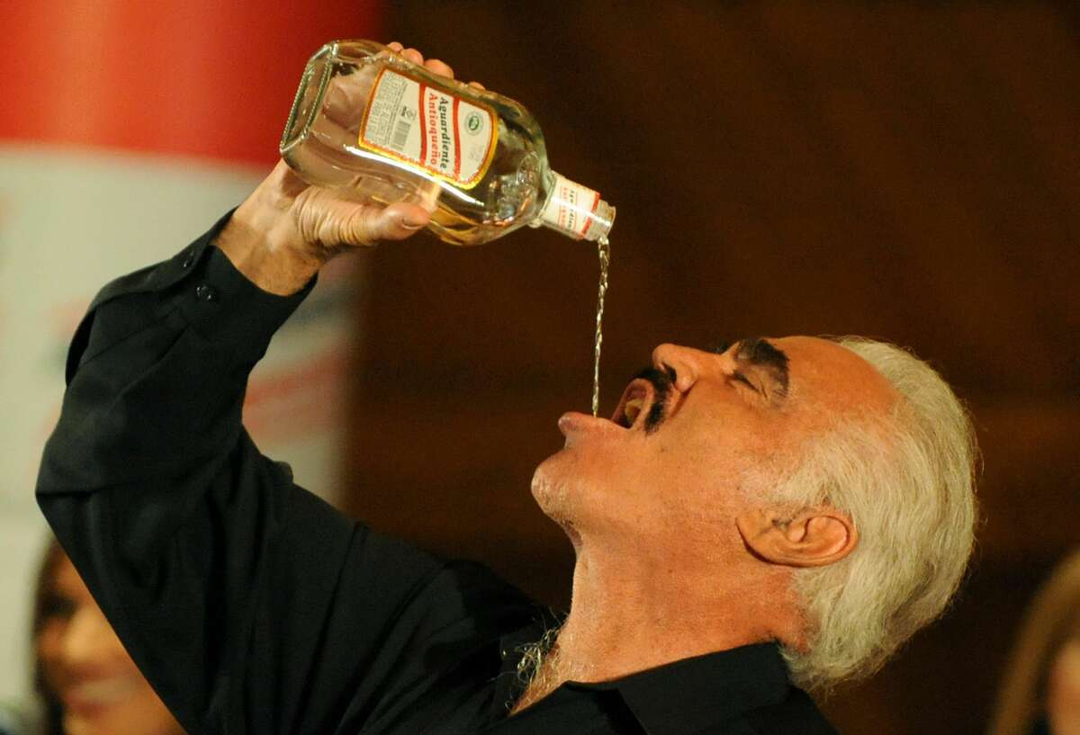 Mexican singer Vicente Fernandez drinks aguardiente during a press conference on February 17, 2009, in Bogota. Fernandez will play in Bogota and nine other cities as part of his
