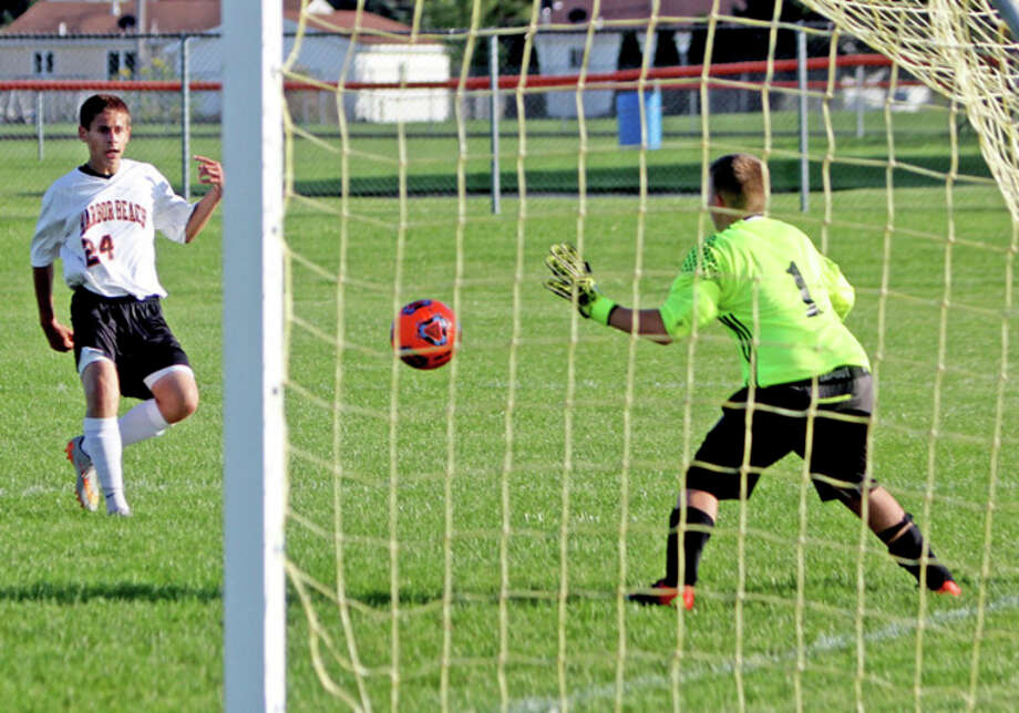 Seth Stapleton/Huron Daily Tribune   Harbor Beach's Ryan Siemen puts a shot on goal during the first half of the Pirates' 8-0 victory over EPBP, Wednesday, in Harbor Beach. Siemen scored on the play.