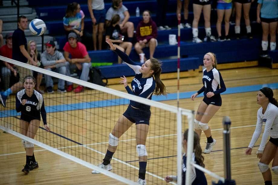 Meridian's Katherine Scheibert spikes the ball on Wednesday at Meridian High School. Photo: Erin Kirkland/Midland Daily News