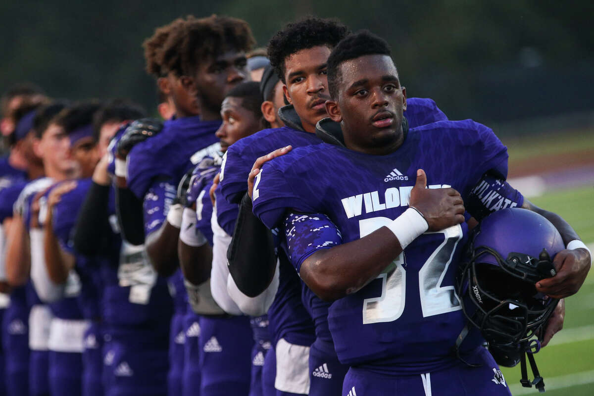 Willis players show their solidarity and respect for the flag during the playing of the national anthem before a Sept. 2 game against C.E. King.