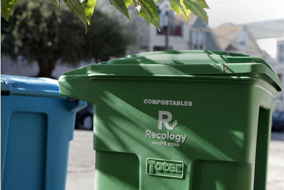 A green compost container stands next to a blue recycling can near Potrero Hill. S.F. isn't even close to its zero waste target. Photo: Gabriella Angotti-Jones, The Chronicle